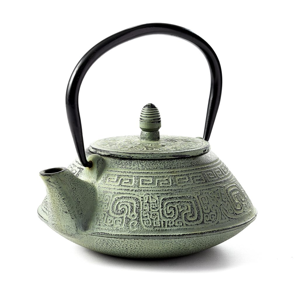 Premium, custom lit photograph of a grey and black clay teapot.